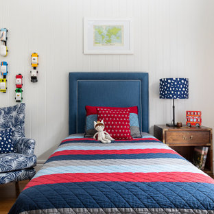 Inspiration for a large transitional kids' bedroom for kids 4-10 years old and boys in Brisbane with white walls, light hardwood floors, brown floor and planked wall panelling.