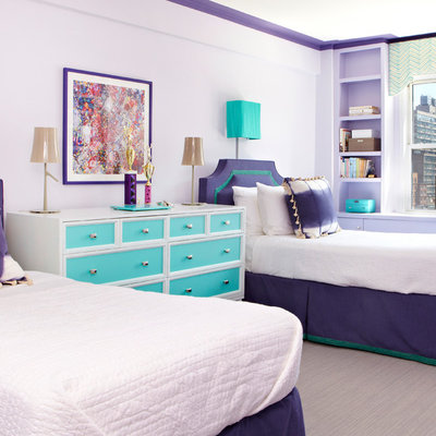 Example of a minimalist girl carpeted kids' room design in New York with purple walls