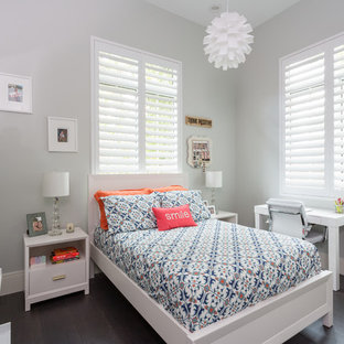 Kids' room - mid-sized transitional girl dark wood floor and brown floor kids' room idea in Miami with gray walls