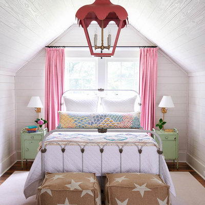 Farmhouse medium tone wood floor and brown floor kids' bedroom photo in Other with white walls