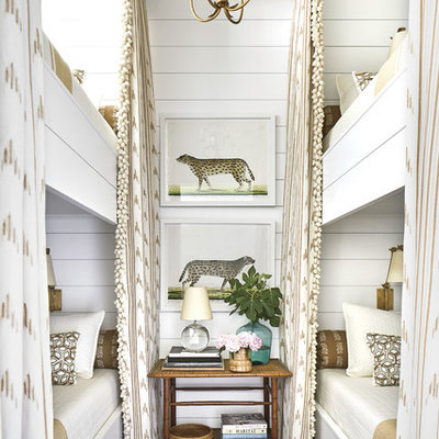 Inspiration for a coastal gender-neutral kids' room remodel in Jacksonville with white walls
