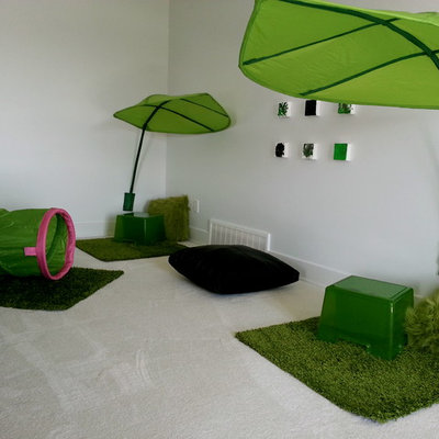 Mid-sized minimalist gender-neutral carpeted playroom photo in Edmonton with white walls