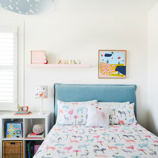 Inspiration for a contemporary kids' bedroom for girls in Melbourne with white walls.