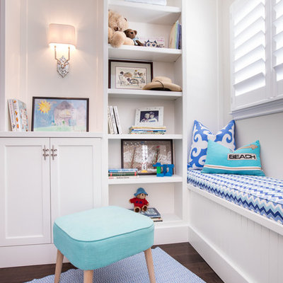 Inspiration for a coastal gender-neutral dark wood floor kids' room remodel in Miami with white walls