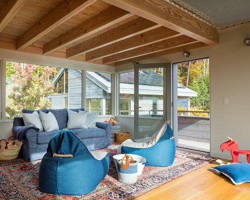 Example Of A Trendy Gender Neutral Medium Tone Wood Floor Playroom Design  In Burlington With