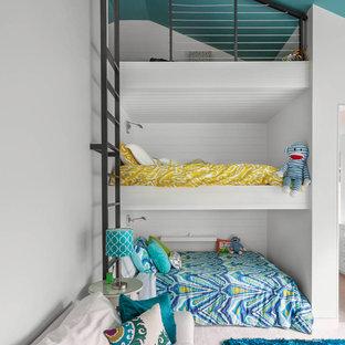 Inspiration pour une chambre d'enfant de 4 à 10 ans design avec un mur blanc.