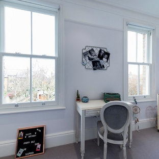 Design ideas for a large traditional kids' study space for girls in London with carpet, grey floors and grey walls.