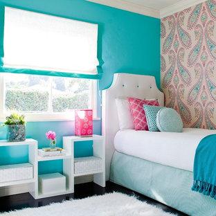 На фото: детская в стиле современная классика с спальным местом, темным паркетным полом и разноцветными стенами для ребенка от 4 до 10 лет, девочки с