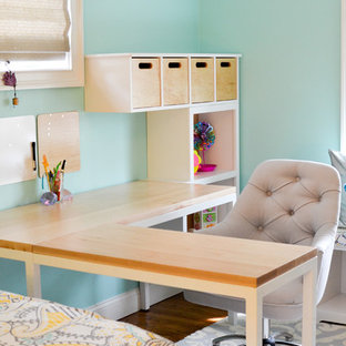 Inspiration for a mid-sized traditional kids' bedroom for girls and kids 4-10 years old in New York with blue walls and dark hardwood floors.