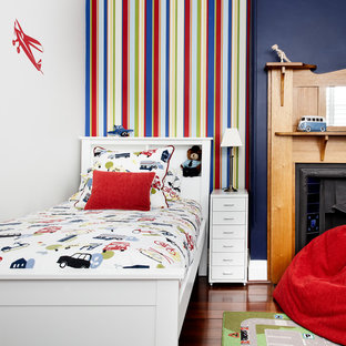 Inspiration for a transitional kids' bedroom for kids 4-10 years old and boys in Melbourne with multi-coloured walls and dark hardwood floors.
