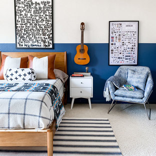 Example of a mid-sized transitional boy carpeted and beige floor kids' room design in Dallas with blue walls