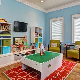 Mid-sized coastal gender-neutral medium tone wood floor kids' room photo in Charleston with blue walls