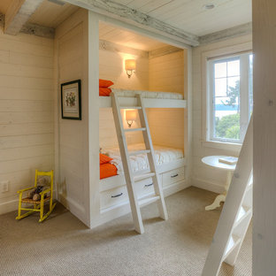 This is an example of a classic toddler's room for girls in Seattle with beige walls and carpet.
