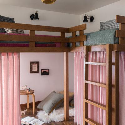 Kids' bedroom - 1950s medium tone wood floor and brown floor kids' bedroom idea in Seattle with white walls