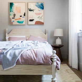 Example of a trendy medium tone wood floor and brown floor kids' room design in San Francisco with gray walls