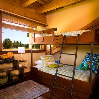 Mountain style gender-neutral dark wood floor kids' room photo in Sacramento with yellow walls
