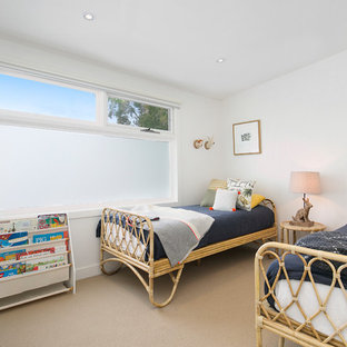 Contemporary gender-neutral kids' bedroom in Sydney with white walls, carpet and beige floor for kids 4-10 years old.