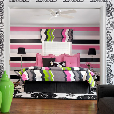 Mid-sized trendy girl medium tone wood floor kids' room photo in Other with multicolored walls