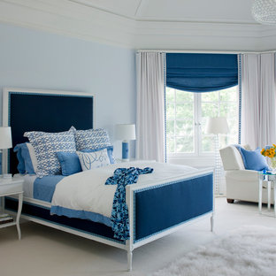 Elegant girl carpeted and beige floor kids' room photo in Providence with blue walls
