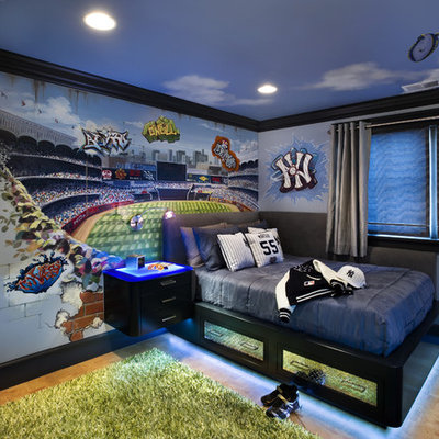 Example of a trendy boy kids' room design in San Francisco with multicolored walls