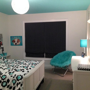 Small transitional girl carpeted kids' room photo in Cleveland with white walls