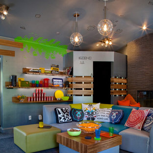 This is an example of an eclectic gender-neutral kids' room in Other with multi-coloured walls and carpet.