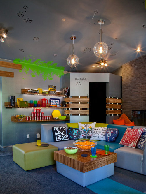 Inspiration for an eclectic gender-neutral carpeted kids' room remodel in  Other with multicolored