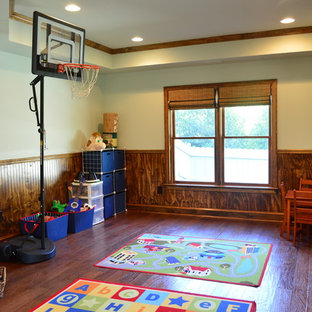 Design ideas for a mid-sized traditional kids' room for kids 4-10 years old and boys in Atlanta with multi-coloured walls and dark hardwood floors.