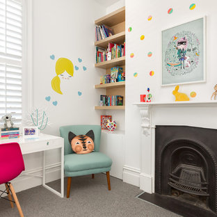 Contemporary kids' study room in Melbourne with white walls, carpet and grey floor for girls.