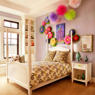 Large transitional girl carpeted kids' room photo in Portland with purple walls