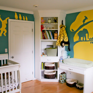 Kids' room - mid-sized traditional gender-neutral light wood floor kids' room idea in Portland with multicolored walls