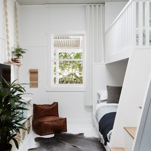 Inspiration for a mid-sized tropical gender-neutral kids' bedroom for kids 4-10 years old in Sydney with white walls, painted wood floors and white floor.