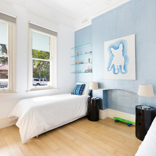 Inspiration for a contemporary kids' bedroom for kids 4-10 years old and boys in Sydney with blue walls and light hardwood floors.