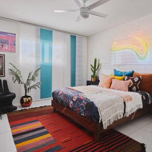 На фото: большая детская в современном стиле с спальным местом, белыми стенами, серым полом и кирпичными стенами для подростка, девочки