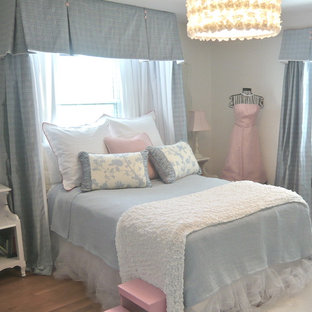 Example of a mid-sized classic girl medium tone wood floor and brown floor kids' room design in Philadelphia with white walls