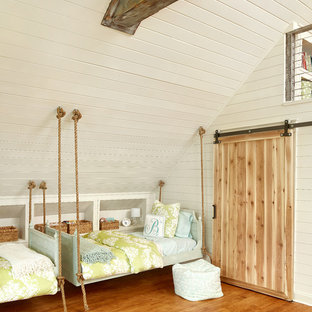 Inspiration for a large coastal kids' room in Charleston with beige walls and medium hardwood flooring.