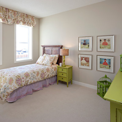 Example of a classic girl kids' room design in Calgary with gray walls