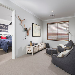 This is an example of a country gender-neutral kids' room in Perth with carpet and grey walls.