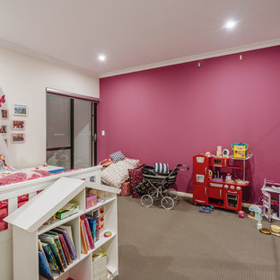Design ideas for a contemporary kids' room for girls in Perth with carpet and multi-coloured walls.