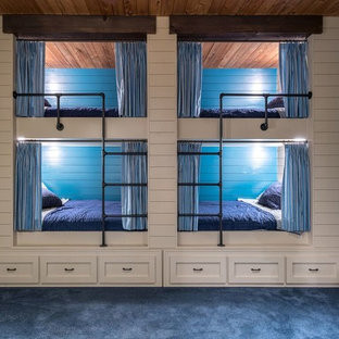 Inspiration for a rustic boy carpeted kids' bedroom remodel in Atlanta with blue walls