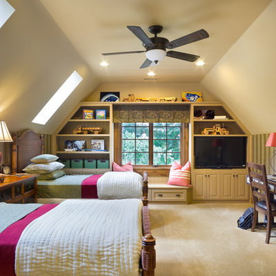 Example of a classic gender-neutral carpeted kids' room design in Portland with beige walls