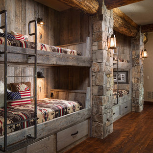 Design ideas for a large rustic gender neutral kids' room in Other with beige walls and dark hardwood flooring.