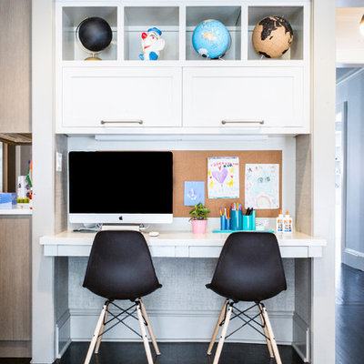 Inspiration for a small transitional gender-neutral dark wood floor kids' room remodel in New York with gray walls