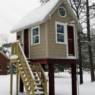 Immagine di una piccola cameretta per bambini da 4 a 10 anni tradizionale con pareti beige