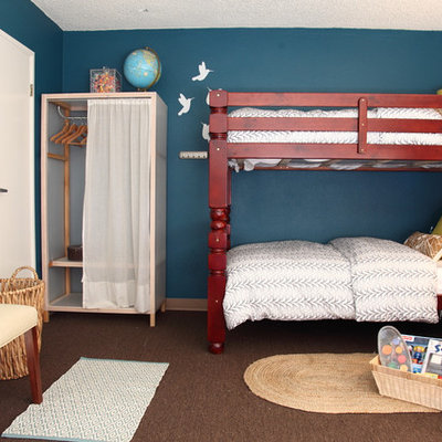 Trendy gender-neutral carpeted kids' room photo in Los Angeles with blue walls