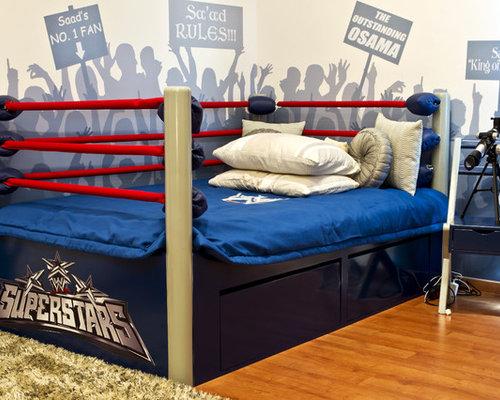 Example of an eclectic boy medium tone wood floor kids' bedroom design in  Other