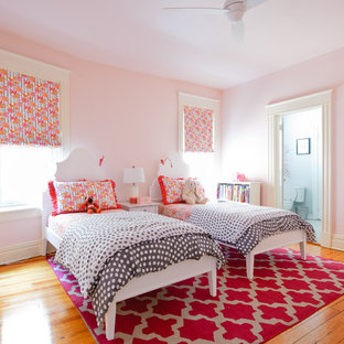 Transitional girl light wood floor kids' bedroom photo in Richmond with pink walls
