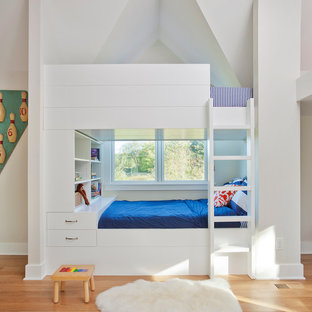 Inspiration for a large timeless boy light wood floor kids' bedroom remodel in Chicago with white walls