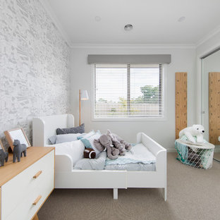 Scandinavian gender-neutral kids' bedroom in Melbourne with grey walls and carpet for kids 4-10 years old.