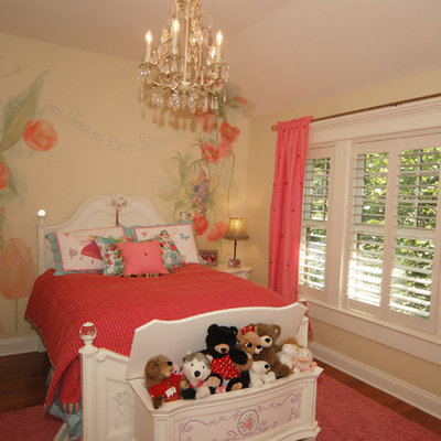 Example of a classic girl medium tone wood floor kids' room design in Tampa with yellow walls